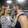Photo - Los Angeles Dodgers starting pitcher Clayton Kershaw, right, greets his wife, Ellen, left, after the Dodgers defeated the Atlanta Braves 4-3 in Game 4 of the National League baseball division series Monday, Oct. 7, 2013, in Los Angeles. The Dodgers advanced to the NL championship series. (AP Photo/Danny Moloshok)