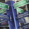 Photo - Street signs for Super Bowl Boulevard point to attractions, Tuesday, Jan. 28, 2014 in New York's Times Square.  Thirteen blocks of midtown Manhattan have been converted into a temporary festival space leading up to the National Football League's championship game between the Seattle Seahawks and the Denver Broncos on  Sunday, Feb. 2, in East Rutherford, N.J. (AP Photo/Mark Lennihan)