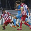 Atletico\'s Raul Garcia, left, and Zenit\'s Axel Witsel struggle for the ball during the Champions League group G soccer match between Zenit and Atletico Madrid at Petrovsky stadium in St.Petersburg, Russia, on Wednesday, Nov. 27, 2013. (AP Photo/Dmitry Lovetsky)