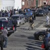 People in cars and on foot line up for free gas in the Jamaica neighborhood of the Queens borough of New York, Saturday, Nov. 3, 2012, in the wake of Superstorm Sandy. Trucks provided by the U.S. Department of Defense at the direction of President Barack Obama at this site and others were deployed in coordination with the New York National Guard at the direction of the governor. (AP Photo/Craig Ruttle) ORG XMIT: NYCR102