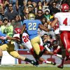 UCLA punt returner Steven Manfro, left, loses the ball in the end zone as Utah defensive back Reggie Topps, second from left, knocks Manfro away to allow Utah\'s Ryan Lacy, second from right, to recover the ball for a touchdown during the first half of their NCAA college football game, Saturday, Oct. 13, 2012, in Pasadena, Calif. (AP Photo/Alex Gallardo)