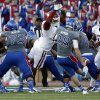 OU\'s Jordan Wade (93) blocks the extra point kick of KU\'s Matthew Wyman (28) in the fourth quarter during of the college football game between the University of Oklahoma Sooners (OU) and the University of Kansas Jayhawks (KU) at Memorial Stadium in Lawrence, Kan., Saturday, Oct. 19, 2013. OU won 34-19. Photo by Sarah Phipps, The Oklahoman