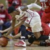 Photo - Rutgers guard Syessence Davis (15) grabs for the ball during the second half of an NCAA college basketball game against Louisville on Tuesday, Jan. 28, 2014, in Piscataway, N.J. Louisville won 80-71. (AP Photo/Mel Evans)