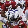 Oklahoma\'s Chuka Ndulue (98) and Corey Nelson (7) bring down TCU \'s Ty Slanina (13) during the college football game between the University of Oklahoma Sooners (OU) and the Texas Christian University Horned Frogs (TCU) at the Gaylord Family-Oklahoma Memorial Stadium on Saturday, Oct. 5, 2013 in Norman, Okla. Photo by Chris Landsberger, The Oklahoman