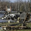 A school bus was flipped and ripped apart in the parking lot of Henryville High School in Henryville, Ind., Friday, March 2, 2012 after an apparent tornado touchdown. No students were injured, but at least one fatality in the community of 2,000 just 20 miles north of Louisville, Ky., was reported. (AP Photo/Garry Jones) ORG XMIT: INGJ103