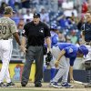 Photo - San Diego Padres manager Bud Black (20) questions home plate umpire Paul Schrieber about a possible interference call that was not called and allowed the Chicago Cubs to score in the 13th inning of a baseball game, Sunday, Aug. 25, 2013, in San Diego. (AP Photo/Lenny Ignelzi)