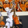 Texas\' Mike Davis (1) makes a catch over Oklahoma State\'s Justin Gilbert (4) during a college football game between Oklahoma State University (OSU) and the University of Texas (UT) at Boone Pickens Stadium in Stillwater, Okla., Saturday, Sept. 29, 2012. Oklahoma State lost 41-36. Photo by Bryan Terry, The Oklahoman