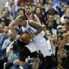 Portland Trail Blazers center Joel Freeland defends against a drive to the basket by Dallas Mavericks\' Monta Ellis (11) during the first half of an NBA basketball game, Saturday, Jan. 18, 2014, in Dallas. (AP Photo/Tony Gutierrez)