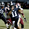 Wayne\'s quarterback Sam Martin (11) keeps the ball around end and scores against Wynnewood in high school Football on Friday, Oct. 26, 2012 in Wayne, Okla. Photo by Steve Sisney, The Oklahoman