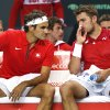 Photo - Switzerland's Stanislas Wawrinka, right, speaks with his doubles partner Roger Federer, left, during their doubles match of the Davis Cup World Group Quarterfinal match between Switzerland and Kazakhstan  in Geneva, Switzerland, Saturday, April 5, 2014.  Roger Federer and Stanislas Wawrinka lost the doubles match to Andrey Golubev and Aleksandr Nedovyesov on Saturday, giving Kazakhstan a 2-1 lead over Switzerland in the Davis Cup quarterfinals. (AP Photo/Keystone,Salvatore Di Nolfi)