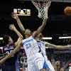 Photo -   New Orleans Hornets forward Anthony Davis (23) leaps for an offensive rebound against Charlotte Bobcats center Byron Mullens (22) during the first half of an NBA preseason basketball game in New Orleans, Tuesday, Oct. 9, 2012. (AP Photo/Gerald Herbert)