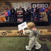 One-year-old Elsie Trandem caries a campaign sign as North Dakota Gov. Jack Dalrymple speaks before introducing Republican U.S. Senate candidate Rick Berg during a campaign stop in Fargo, N.D, Sunday, Nov. 4, 2012. Berg is running against Democrat Heidi Heitkamp for North Dakota\'s U.S Senate seat. (AP Photo/LM Otero)