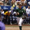USF\'s Jessica Mouse (14) throws a ball to first base during a Women\'s College World Series game between Louisiana State University and the University of South Florida at ASA Hall of Fame Stadium in Oklahoma City, Saturday, June 2, 2012. Photo by Garett Fisbeck, The Oklahoman