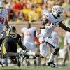 Oklahoma State\'s Joseph Randle (1) breaks away from Missouri\'s Kenji Jackson (13) in front of Oklahoma State\'s Grant Garner (74) in the first quarter during a college football game between the Oklahoma State University Cowboys (OSU) and the University of Missouri Tigers (Mizzou) at Faurot Field in Columbia, Mo., Saturday, Oct. 22, 2011. Photo by Nate Billings, The Oklahoman