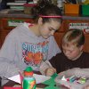 Sophomore Brittney Minx shares her knowledge of geometry with Alex Bertolino, a first-grade student at Oklahoma Christian Academy. The sophomore geometry class applied math principles to making pop-up children\'s books. Community Photo By: Nyla Hackett Submitted By: Nyla, Edmond