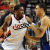 Photo - Golden State Warriors guard Klay Thompson (11) defends as Portland Trail Blazers guard Wesley Matthews (2) makes a move to the basket during the first half of an NBA basketball game in Portland, Ore., Sunday, April 13, 2014. (AP Photo/Steve Dykes)