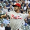 Photo - Philadelphia Phillies starting pitcher Cole Hamels throws during the first inning of a baseball game against the Milwaukee Brewers Monday, July 7, 2014, in Milwaukee. (AP Photo/Morry Gash)