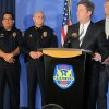 Photo - Phoenix Mayor Greg Stanton, second from right, speaks at a news conference announcing an arrest on Monday, June 16, 2014.    Gary Michael Moran, 54,  an ex-convict is being held for an attack that left one priest dead and another injured at a Roman Catholic church in Phoenix, connecting forensic evidence from the crime scene with the suspect.   (AP Photo/Brian Skoloff)