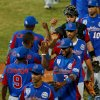 Photo - Players of the Dominican Republic celebrate after they defeated Cuba 9-2 during a Caribbean Series baseball game in Porlamar, Venezuela, Monday, Feb. 3, 2014. (AP Photo/Fernando Llano)