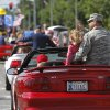 Air Force Col. Steven Bleymaier and his daughter, Caroline, 5, ride on the back seat of a Mustang in the parade. Bleymaier is commander for the 72nd Air Base. Wing. He is the base commander for Tinker AFB. Del City and eastern Oklahoma County residents lined S. Sunnylane Road to show their support for America\'s military, applauding and cheering participants who marched and rode in the city\'s Armed Forces Day Parade on Saturday morning, May, 19, 2012. The parade worked its way along the Del City route for a little more than an hour. Photo by Jim Beckel, The Oklahoman