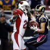 Photo -   St. Louis Rams wide receiver Danny Amendola, right, catches a 44-yard pass as Arizona Cardinals cornerback Patrick Peterson defends during the first quarter of an NFL football game, Thursday, Oct. 4, 2012, in St. Louis. (AP Photo/Jeff Roberson)