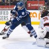 Photo - Toronto Maple Leafs forward James van Riemsdyk, left, misses a scoring chance against New Jersey Devils goalie Cory Schneider (35) during second period NHL hockey action in Toronto on Sunday, Jan. 12, 2014. (AP Photo/The Canadian Press, Nathan Denette)