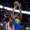 Golden State Warriors forward Carl Landry (7) shoots over Toronto Raptors forward Amir Johnson during the first half of their NBA basketball game, Monday, Jan. 28, 2013, in Toronto. (AP Photo/The Canadian Press, Frank Gunn)