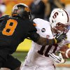 Oklahoma State\'s Daytawion Lowe (8) tips the ball away from Stanford\'s Geoff Meinken (10) in the end zone during the first half of the Fiesta Bowl NCAA college football game Monday, Jan. 2, 2012, in Glendale, Ariz.(AP Photo/Ross D. Franklin)