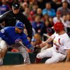 Photo - St. Louis Cardinals' Peter Bourjos steals third as Chicago Cubs third baseman Luis Valbuena is late with the tag during the sixth inning of a baseball game Tuesday, May 13, 2014, in St. Louis. (AP Photo/Scott Kane)