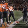 Oklahoma\'s Roy Finch (22) picks himself off the field as Oklahoma State\'s Jamie Blatnick (50) celebrates his fumble recovery with teammates during the Bedlam college football game between the Oklahoma State University Cowboys (OSU) and the University of Oklahoma Sooners (OU) at Boone Pickens Stadium in Stillwater, Okla., Saturday, Dec. 3, 2011. Photo by Chris Landsberger, The Oklahoman