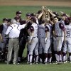 Photo - Texas A&M players gather following a 5-3 loss to Missouri in a Big 12 conference tournament college baseball game in Oklahoma City, Thursday, May 24, 2012. (AP Photo/Sue Ogrocki) ORG XMIT: OKSO126