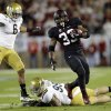Stanford running back Stepfan Taylor (33) carries past UCLA defensive end Cassius Marsh (99) and linebacker Eric Kendricks (6) during the second half of the Pac-12 championship NCAA college football game in Stanford, Calif., Friday, Nov. 30, 2012. (AP Photo/Marcio Jose Sanchez)