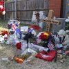 Photo - The memorial to Australian Christopher Lane remains at the site where he was killed Aug. 16 in Duncan. Three Duncan teenagers have been charged in the killing. (AP Photo/Sue Ogrocki)  Sue Ogrocki - AP
