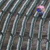 Fans wait out a rain delay before a baseball game between the Chicago Cubs and the Cincinnati Reds in Chicago, Thursday, Aug. 9, 2012. (AP Photo/Paul Beaty)