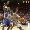 Tony Crocker of OU drives around Rod Earls of Tulsa during the college basketball game between the University of Oklahoma and Tulsa at the Lloyd Noble Center in Norman, Okla., Wednesday, Dec., 5, 2007. By Bryan Terry, The Oklahoman