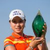 Hee Young Park, of South Korea, holds the trophy after her victory in the Manulife Financial LPGA Classic golf tournament in Waterloo, Ontario, Sunday, July 14, 2013. (AP Photo/The Canadian Press, Geoff Robins)