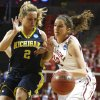 Oklahoma\'s Morgan Hook (10) tries to get around Michigan\'s Courtney Boylan (2) during a first round game of the NCAA women\'s basketball tournament between the University of Oklahoma Sooners and the Michigan Wolverines at Lloyd Noble Center in Norman, Okla., Sunday, March 18, 2012. Photo by Bryan Terry, The Oklahoman