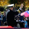 Photo -   Crowds wave to Navy Capt. Jim Minta as he participates in the 31st annual Veterans Day Parade in downtown Atlanta, Saturday, Nov. 10, 2012. (AP Photo/David Tulis)