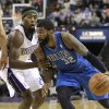 Photo - Dallas Mavericks guard O.J. Mayo, right, drives against Sacramento Kings forward John Salmons during the first quarter of an NBA basketball game in Sacramento, Calif., Friday, April 5, 2013. (AP Photo/Rich Pedroncelli)
