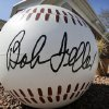 Photo - ADVANCE FOR WEEKEND, APRIL 25-27 - A large baseball sits outside the entrance to the Bob Feller Museum, Friday, April 11, 2014, in Van Meter, Iowa. In this tiny town west of Des Moines, things have slowed down considerably at the museum, a shrine to the Cleveland Indians star who died three years ago. Visitors are rare, the schedule is shorter and there is growing concern that the museum will be shuttered. (AP Photo/Charlie Neibergall)