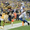 Photo - Pittsburgh Steelers wide receiver Antonio Brown (84) gets into the end zone ahead of Detroit Lions strong safety Glover Quin (27) for a touchdown in the first half of an NFL football game on Sunday, Nov. 17, 2013, in Pittsburgh. (AP Photo/Don Wright)