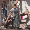 MAY 3, 1999 TORNADO: Tornado victims, damage: Navy ensign Bernard Calamug, stationed at Tinker Air Force Base, sorting through debris for personal items in his second floor apartment at the Emerald Spring Apartments across from West Moore High School, 12500 S Western. Calamug is holding winter gear.
