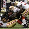 Photo -   New Orleans Saints running back Mark Ingram (28) loses the ball as he is tackled by San Francisco 49ers defensive end Justin Smith (94) and inside linebacker NaVorro Bowman (53) in the first half of an NFL football game in New Orleans, Sunday, Nov. 25, 2012. (AP Photo/Bill Feig)