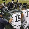 New York Jets\' Tim Tebow (15) kneels with other players in a prayer circle after the Jets lost to the Seattle Seahawks during an NFL football game, Sunday, Nov. 11, 2012, in Seattle. The Seahawks won 28-7. (AP Photo/Elaine Thompson)