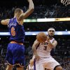Phoenix Suns\' Jared Dudley (3) passes around New York Knicks\' Tyson Chandler (6) during the second half of an NBA basketball game, Wednesday, Dec. 26, 2012, in Phoenix. The Knicks won 99-97. (AP Photo/Matt York)