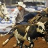 Photo - Aaron Vosler of of Cheyenne, Wyo., competes in steer wrestling during the National Circuit Finals Rodeo at the Lazy E Arena in Guthrie, Okla., Saturday afternoon, April 12, 2014. Photo by Nate Billings, The Oklahoman