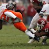 Lendy Holmes (11) brings down Dantrell Savage (22) for no gain during the first half of the college football game between the University of Oklahoma Sooners (OU) and the Oklahoma State University Cowboys (OSU) at the Gaylord Family-Memorial Stadium on Saturday, Nov. 24, 2007, in Norman, Okla. Photo By STEVE SISNEY, The Oklahoman