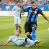 Photo - Sporting Kansas City's Aurelien Collin slides in as he tries to block the pass to Montreal Impact's Krzysztof Krol during the first half of a soccer game, Saturday, July 12, 2014 in Montreal. (AP Photo/The Canadian Press, Peter McCabe)