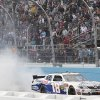 Driver Joey Logano does a burnout in front of the grandstands after winning the NASCAR Nationwide Series auto race Saturday, Nov. 10, 2012, at Phoenix International Raceway in Avondale, Ariz.(AP Photo/Paul Connors)