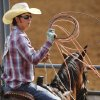 Team roping contestant Parker Cudd of Gatesville, TX, coils his rope while waiting to compete during the morning go-round at the IFYR rodeo on Thursday, July 11, 2013. July 10, 2013. Photo by Jim Beckel, The Oklahoman.